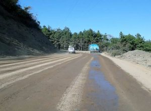 Strengthening and widening to two lane with paved shoulder of NH-61